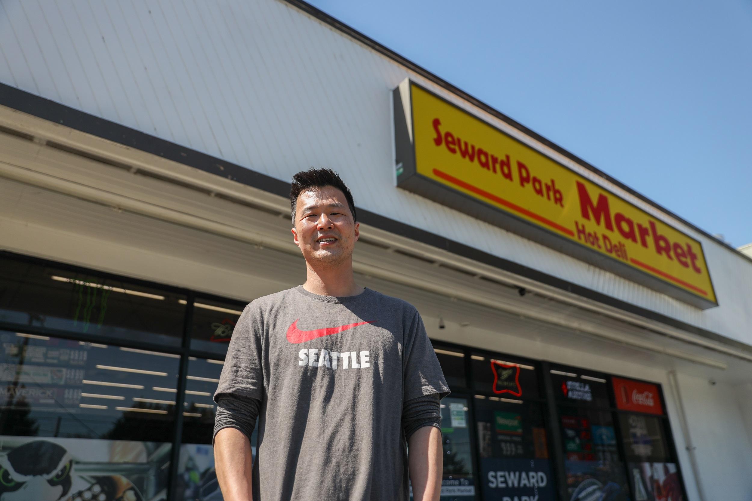 Richard wearing a Seattle t-shirt standing in front of Seward Park Market